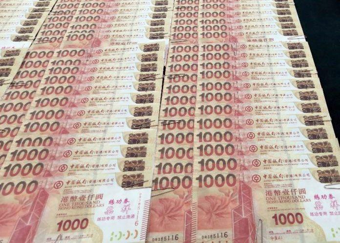 內地漢黑吃黑詐騙換錢黨近7萬人幣 司警接報拉人檢84張練功券